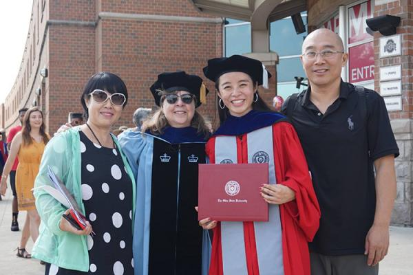 Graduate student and her family at graduation